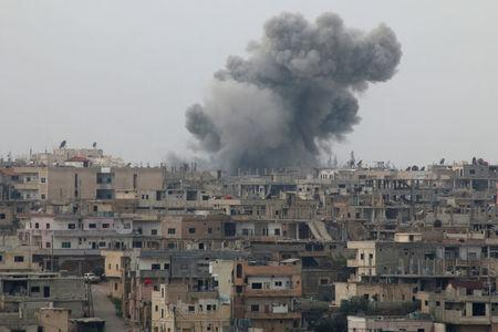 Smoke rises after strikes on rebel-held Deraa city