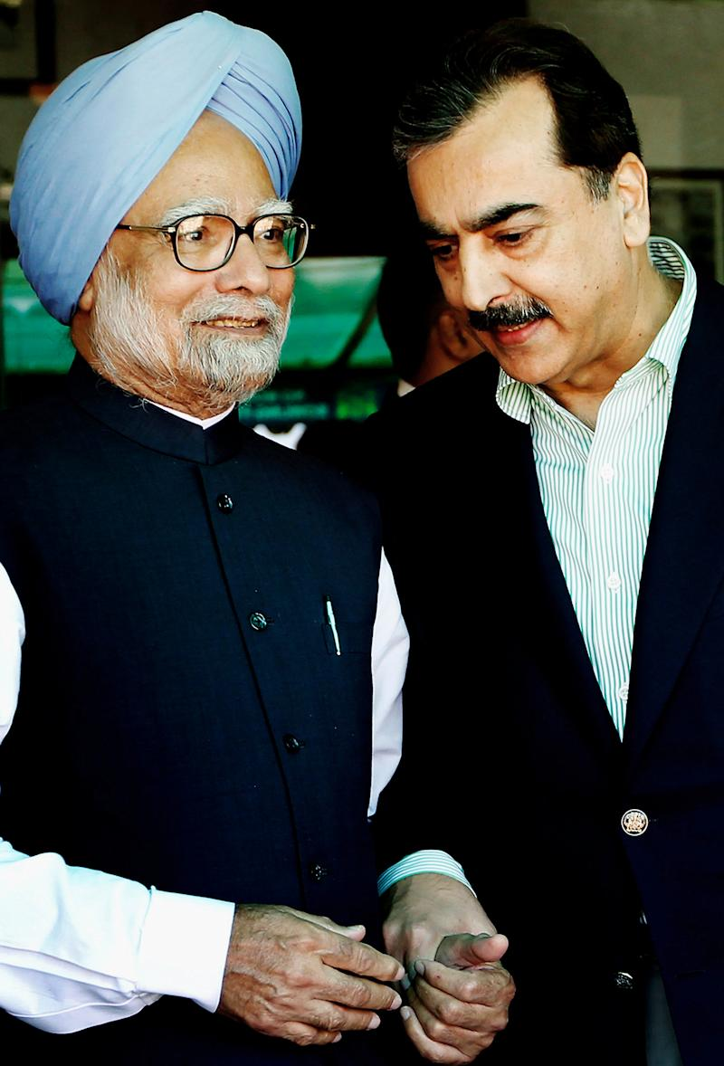 Indian Prime Minister Manmohan Singh, left, and Pakistan Prime Minister Yousuf Raza Gilani, prior to the start of the Cricket World Cup semifinal match between Pakistan and India in Mohali, India, Wednesday, March 30, 2011. The prime ministers of India and Pakistan, mixing business with pleasure, joined tens of thousands of cricket fans in a northern Indian stadium Wednesday to watch a key match between their rival nations. (AP Photo/Daniel Berehulak, Pool)