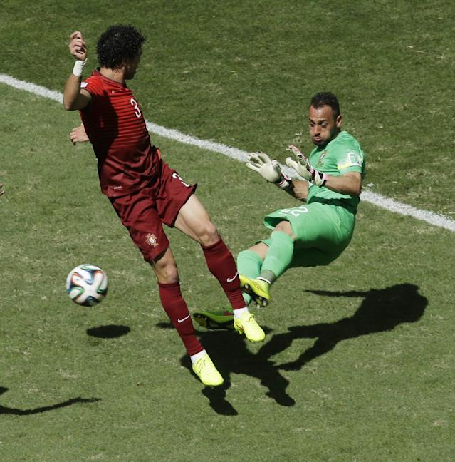 Portugal's goalkeeper Beto, right, and Portugal's Pepe stop a shot during the group G World Cup soccer match between Portugal and Ghana at the Estadio Nacional in Brasilia, Brazil, Thursday, June 26, 2014. (AP Photo/Themba Hadebe)