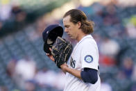 Seattle Mariners starting pitcher Logan Gilbert turns toward the outfield and pauses before throwing his first major league pitch, against the Cleveland Indians in the first inning of a baseball game Thursday, May 13, 2021, in Seattle. (AP Photo/Elaine Thompson)