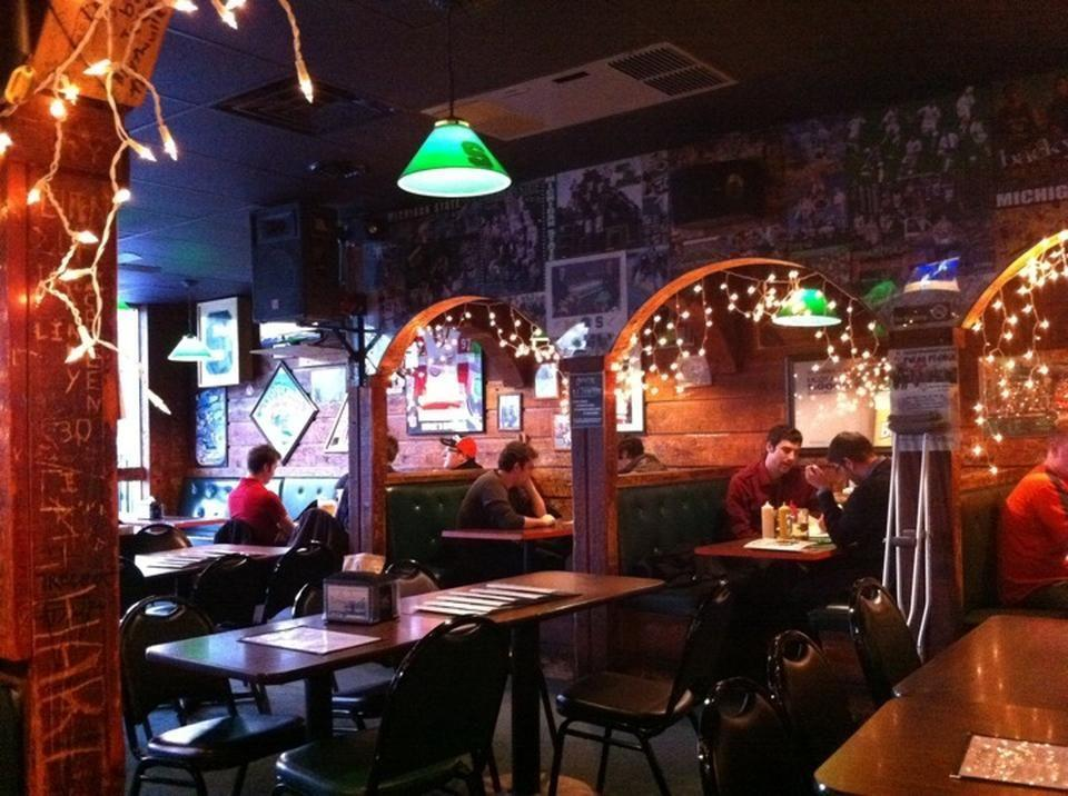 """<p>This laid-back bar and eatery, decked out in Sparty memorabilia, is the perfect place to start and end the night. Get going with <a href=""""https://go.redirectingat.com?id=74968X1596630&url=https%3A%2F%2Fwww.tripadvisor.com%2FRestaurant_Review-g42159-d458792-Reviews-Crunchy_s-East_Lansing_Ingham_County_Michigan.html&sref=https%3A%2F%2Fwww.bestproducts.com%2Ffun-things-to-do%2Fg2528%2Fbest-college-bars%2F"""" rel=""""nofollow noopener"""" target=""""_blank"""" data-ylk=""""slk:Crunchy's"""" class=""""link rapid-noclick-resp"""">Crunchy's</a> impressive pizza, burgers, and craft beers, and stick around for low-key karaoke.</p>"""