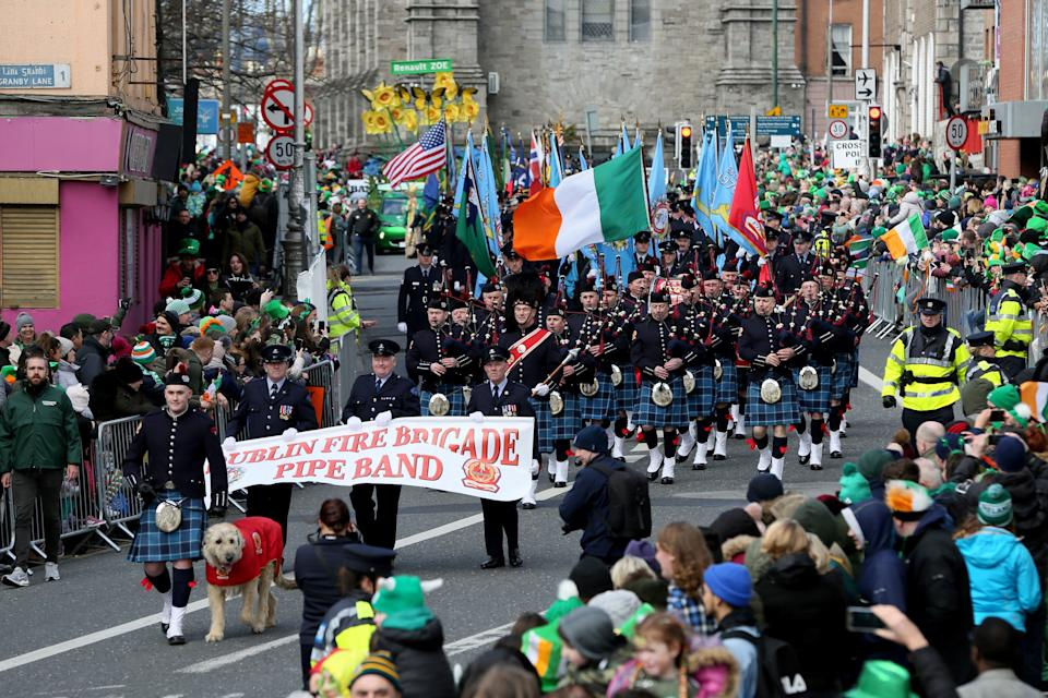 Crowds line the route during the annual St Patricks Day parade through the city centre of Dublin on March 17, 2019. (Photo by Paul FAITH / AFP)        (Photo credit should read PAUL FAITH/AFP via Getty Images)