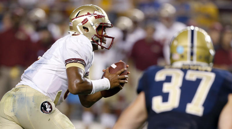 Florida State quarterback Jameis Winston (5) runs away from Pittsburgh defensive lineman David Durham (37) for a touchdown in the second quarter of an NCAA college football game, Monday, Sept. 2, 2013, in Pittsburgh. (AP Photo/Keith Srakocic)