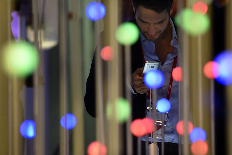 A visitor at the 2015 Mobile World Congress in Barcelona, where experts have warned of the dangers of sensitive health data on mobile phone ending up in the wrong hands (AFP Photo/Lluis Gene)