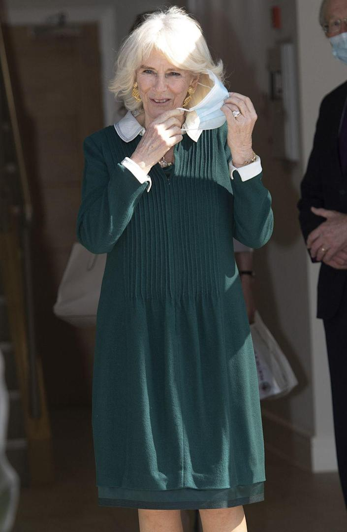 <p>Camilla wore a collared green and white dress and gold statement earrings while visiting frontline workers at a pharmacy in Sussex. <br></p>