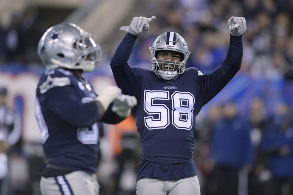 Dallas Cowboys defensive end Robert Quinn triggered a big roster bonus Sunday night. (AP Photo/Bill Kostroun)