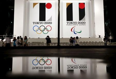 FILE PHOTO: Tokyo 2020 Olympic and Paralympic games emblems are displayed at Tokyo Metropolitan Government Building in Tokyo July 24, 2015. REUTERS/Issei Kato