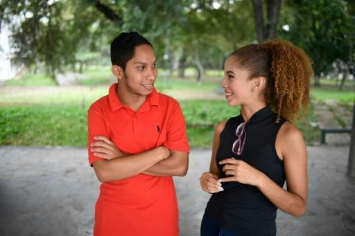 Venezuelan student John Alvarez, 20, and his girlfriend Amanda Aquino, 19, who have to sneak in trysts at his parent's house when his family is asleep