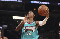 Memphis Grizzlies guard Ja Morant (12) goes up for a basket during the first half of the team's NBA basketball game against the Cleveland Cavaliers on Friday, Jan. 17, 2020, in Memphis, Tenn. (AP Photo/Karen Pulfer Focht)