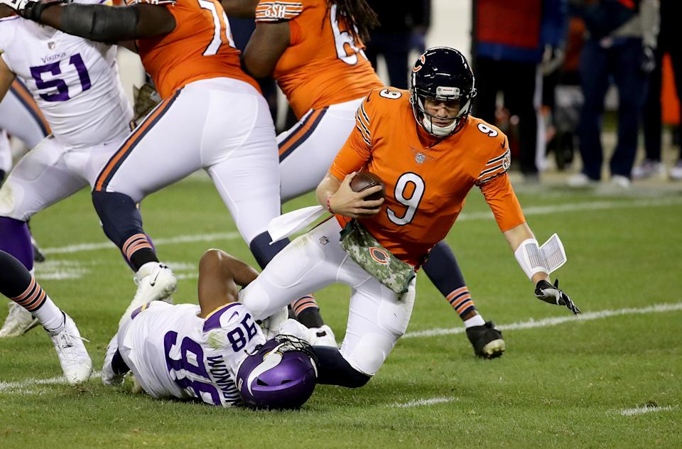 Nick Foles is sacked by D.J. Wonnum of the Minnesota Vikings on Monday night. (Photo by Jonathan Daniel/Getty Images)