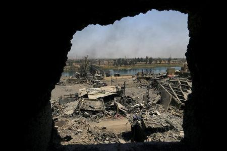 An old bridge destroyed by clashes is seen in the Old City of Mosul, Iraq July 10, 2017. REUTERS/Thaier Al-Sudani
