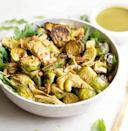 "<p>You may not think of ""salad"" when you consider Thanksgiving dinner, but it's a good way to get in greens. This Brussels sprouts salad from <a href=""https://www.wholesomelicious.com/roasted-brussels-sprouts-salad-with-mustard-basil-vinaigrette/"" rel=""nofollow noopener"" target=""_blank"" data-ylk=""slk:Wholesomelicious"" class=""link rapid-noclick-resp"">Wholesomelicious </a>is perfect, as it has crunch from almonds and a spicy kick from the Dijon mustard, and it's still low-carb.</p>"