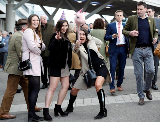 Horse Racing - Cheltenham Festival - Cheltenham Racecourse, Cheltenham, Britain - March 13, 2018 Racegoers pose during the Cheltenham Festival REUTERS/Darren Staples
