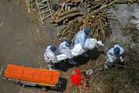 Crematoriums in New Delhi are facing shortages of wood because of the surge in deaths, locad media said