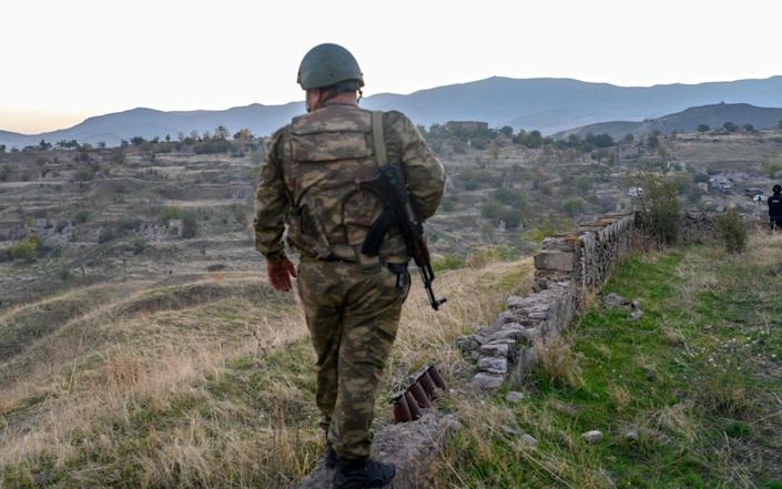 An Azeri soldier stands in the city of Jabrayil, where Azeri forces regained control during the fighting with Armenia over the breakaway region of Nagorno-Karabakh on October 16, 2020. - AFP