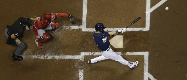 Milwaukee Brewers' Christian Yelich hits a double during the first inning of a baseball game against the Cincinnati Reds Wednesday, Sept. 19, 2018, in Milwaukee. (AP Photo/Morry Gash)