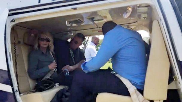 PHOTO: U.S. tourist Kimberly Sue Endicott is seen after her rescue as she departs for Kampala, Uganda, in this still image taken from a video obtained by social media on April 9, 2019. (Wild Frontiers via Reuters)