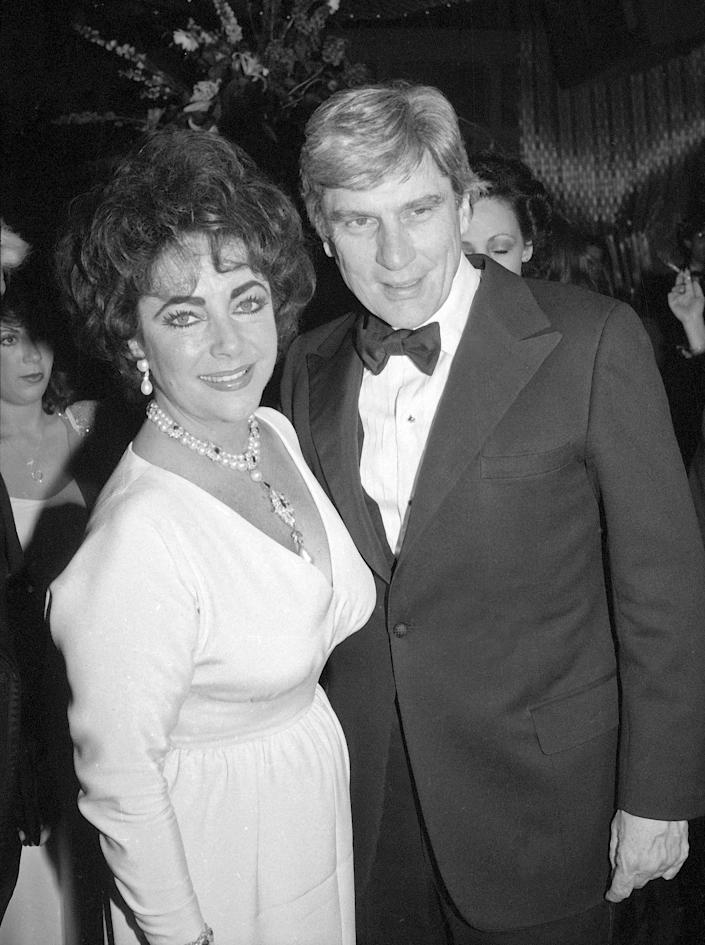 FILE - In this May 7, 1981 file photo actress Elizabeth Taylor and her husband Sen. John Warner, R-Va., arrive at Xenon disco in New York. Warner, a former Navy secretary and one of the Senate's most influential military experts, died Tuesday, May 25, 2021, at age 94, his longtime chief of staff said Wednesday, May 26 (AP Photo/Richard Drew, File)
