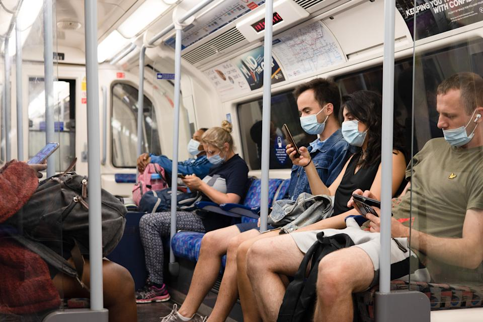 People wearing face masks in the underground after majority of the COVID 19 restrictions were lifted on 19th July yet the mayor of London announced facial coverings are still mandatory. (Photo by Hesther Ng / SOPA Images/Sipa USA)