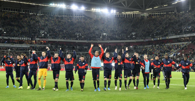 Leipzig's players celebrate with fans after winning the German Bundesliga soccer match between Fortuna Duesseldorf and RB Leipzig in Duesseldorf, Germany, Saturday, Dec. 14, 2019. Fortuna was defeated by Leipzig with 0-3. (AP Photo/Martin Meissner)