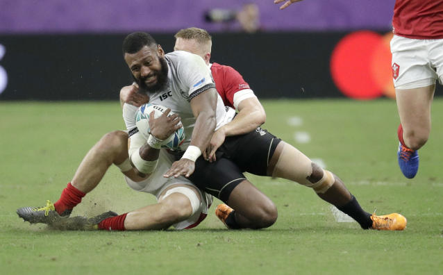 Fiji's Waisea Nayacalevu is tackled during the Rugby World Cup Pool D game at Oita Stadium between Wales and Fiji in Oita, Japan, Wednesday, Oct. 9, 2019. (AP Photo/Aaron Favila)