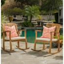 """<p><strong>Coyne Acacia</strong></p><p>wayfair.com</p><p><strong>$299.99</strong></p><p><a href=""""https://go.redirectingat.com?id=74968X1596630&url=https%3A%2F%2Fwww.wayfair.com%2Foutdoor%2Fpdp%2Fbeachcrest-home-coyne-acacia-rocking-chair-with-cushion-w004846776.html&sref=https%3A%2F%2Fwww.thepioneerwoman.com%2Fhome-lifestyle%2Fdecorating-ideas%2Fg36491091%2Foutdoor-rocking-chairs%2F"""" rel=""""nofollow noopener"""" target=""""_blank"""" data-ylk=""""slk:Shop Now"""" class=""""link rapid-noclick-resp"""">Shop Now</a></p><p>Made of solid, water-resistant acacia wood, this rocking chair bundle has everything you need. The natural hardwood finish will look sleek in any space, plus it comes with two comfy cushions.</p>"""