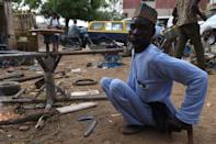 A polio victim arrives in his welding workshop in Kano, northern Nigeria