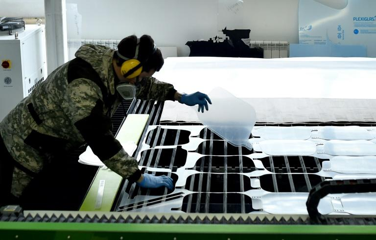 An employee controls the production of protective shields at the Dalisia factory in Minsk