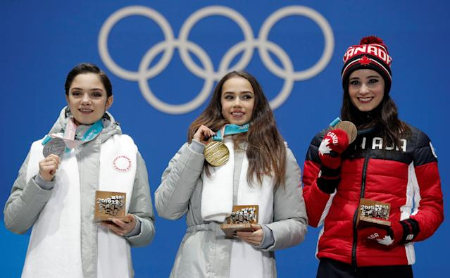 Medals Ceremony - Figure Skating - Pyeongchang 2018 Winter Olympics - Women Single Skating free skating - Medals Plaza - Pyeongchang, South Korea - February 23, 2018 - Gold medalist Alina Zagitova, an Olympic Athlete from Russia, silver medalist Evgenia Medvedeva, an Olympic Athlete from Russia, and bronze medalist Kaetlyn Osmond of Canada on the podium. REUTERS/Eric Gaillard TPX IMAGES OF THE DAY