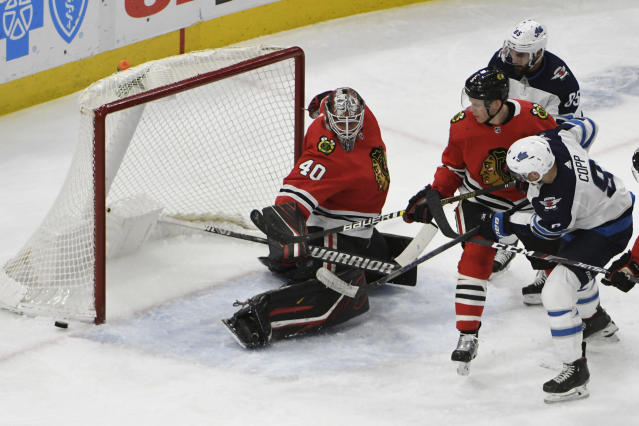 Chicago Blackhawks goaltender Robin Lehner (40) makes a save on Winnipeg Jets center Andrew Copp (9) during the second period of an NHL hockey game Sunday, Jan. 19, 2020, in Chicago. (AP Photo/David Banks)