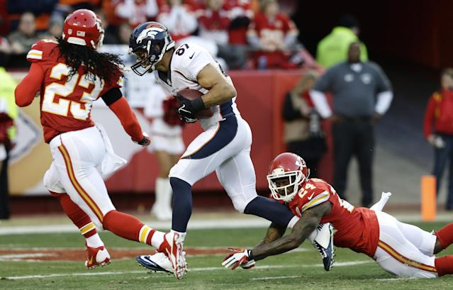 Denver Broncos wide receiver Eric Decker (87) runs to the end zone for a touchdown against Kansas City Chiefs cornerback Brandon Flowers (24) and free safety Kendrick Lewis (23) during the first half of an NFL football game, Sunday, Dec. 1, 2013, in Kansas City, Mo. (AP Photo/Charlie Riedel)