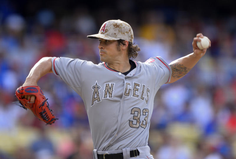 Los Angeles Angels starting pitcher C.J. Wilson throws to the plate during the first inning of their baseball game against the Los Angeles Dodgers, Monday, May 27, 2013, in Los Angeles. (AP Photo/Mark J. Terrill)