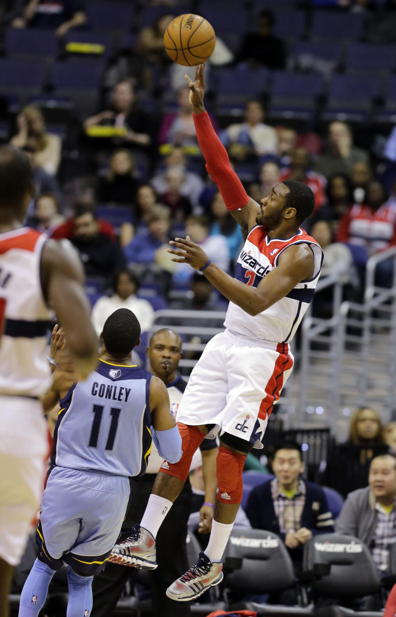 Washington Wizards guard John Wall (2)  shoots over Memphis Grizzlies guard Mike Conley (11) in the first half of an NBA basketball game Monday, March 25, 2013 in Washington. (AP Photo/Alex Brandon)