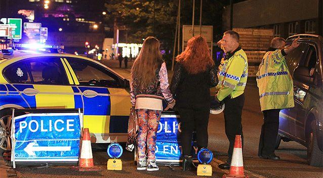 Police assist young concertgoers in the streets of Manchester. Source: AP