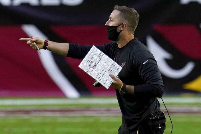 Arizona Cardinals head coach Kliff Kingsbury makes a call during the second half of an NFL football game against the Miami Dolphins, Sunday, Nov. 8, 2020, in Glendale, Ariz. (AP Photo/Ross D. Franklin)