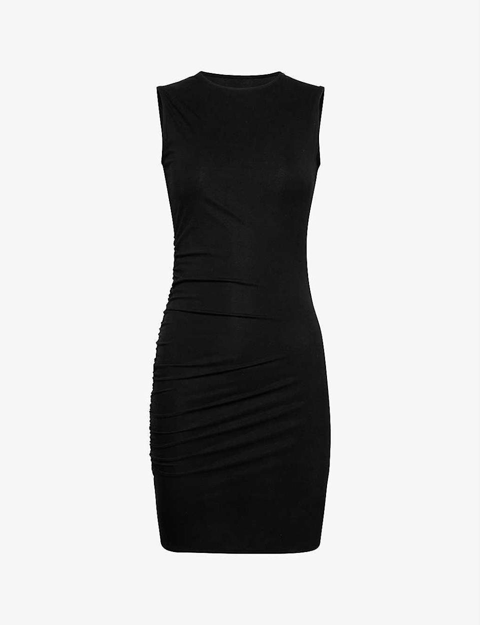 """Is this the LBD to end all LBDs? Quite possibly. Amina Muaddi is a footwear designer and this dress is the result of her collaboration with hosiery staple Wolford. It drapes and ruches in all the right places. If I could justify another LBD, I would buy it. <br><br><strong>AMINA MUADDI X WOLFORD</strong> Draped Stretch-jersey Mini Dress, $, available at <a href=""""https://www.selfridges.com/GB/en/cat/amina-muaddi-x-wolford-draped-stretch-jersey-mini-dress_R03802242/"""" rel=""""nofollow noopener"""" target=""""_blank"""" data-ylk=""""slk:Selfridges"""" class=""""link rapid-noclick-resp"""">Selfridges</a>"""