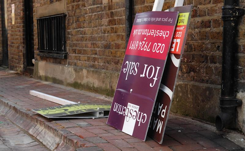 House prices property market estate agent signs