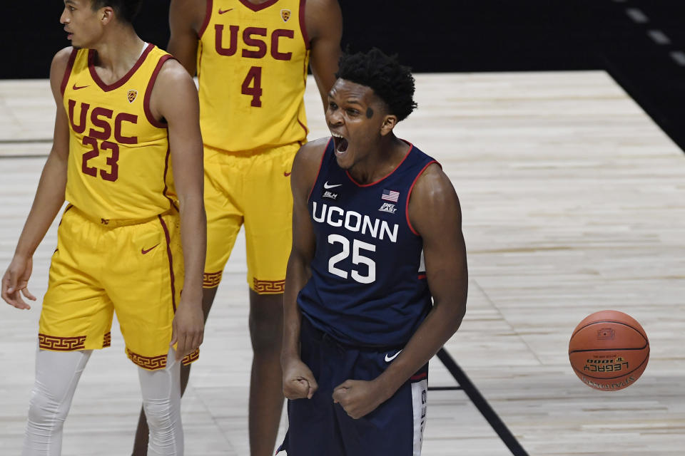 Connecticut's Josh Carlton (25) reacts to a call in UConn's favor during the first half of an NCAA college basketball game against Southern California, Thursday, Dec. 3, 2020, in Uncasville, Conn. (AP Photo/Jessica Hill)