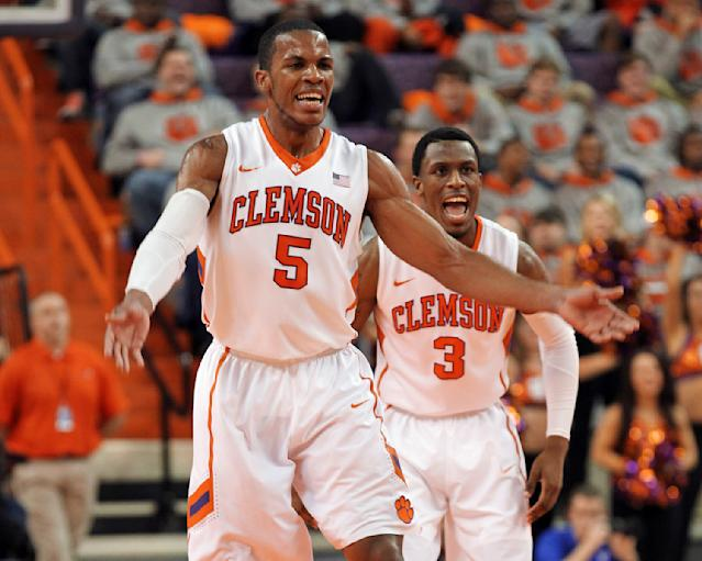 Clemson's Jaron Blossomgame (5) and Adonis Filer (3) celebrate during the Tigers' 72-59 win over Duke during an NCAA college basketball game Saturday, Jan. 11, 2014, in Clemson, S.C. (AP Photo/Anderson Independent-Mail, Mark Crammer)