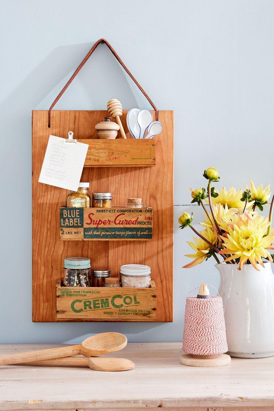 """<p>Repurpose an old cutting board by using screws to attach small <a href=""""https://go.redirectingat.com?id=74968X1596630&url=https%3A%2F%2Fwww.etsy.com%2Fsearch%3Fq%3Dwooden%2Bcheese%2Bbox&sref=https%3A%2F%2Fwww.countryliving.com%2Fdiy-crafts%2Ftips%2Fg645%2Fcrafty-christmas-presents-ideas%2F"""" rel=""""nofollow noopener"""" target=""""_blank"""" data-ylk=""""slk:wooden cheese boxes"""" class=""""link rapid-noclick-resp"""">wooden cheese boxes</a> to a rectangular cutting board. Then add a leather strap for hanging. </p><p><strong><a class=""""link rapid-noclick-resp"""" href=""""https://go.redirectingat.com?id=74968X1596630&url=https%3A%2F%2Fwww.etsy.com%2Fsearch%3Fq%3Dwooden%2Bcheese%2Bbox&sref=https%3A%2F%2Fwww.countryliving.com%2Fdiy-crafts%2Ftips%2Fg645%2Fcrafty-christmas-presents-ideas%2F"""" rel=""""nofollow noopener"""" target=""""_blank"""" data-ylk=""""slk:SHOP WOODEN BOXES"""">SHOP WOODEN BOXES</a></strong></p>"""