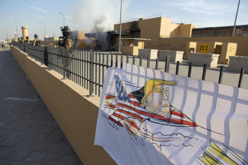 Iraqi army soldiers are deployed in front of the U.S. embassy, in Baghdad, Iraq, Wednesday, Jan. 1, 2020. Iran-backed militia have withdrawn from the U.S. Embassy compound in Baghdad after two days of clashes with American security forces. (AP Photo/Nasser Nasser)