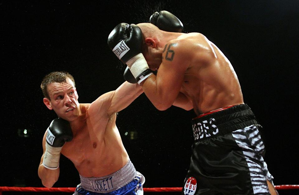 Gary Lockett (left) fires a punch at Ryan Rhodes during the for the WBU Middleweight Championship of the World at the Millennium Stadium, Cardiff.   (Photo by David Davies - PA Images/PA Images via Getty Images)