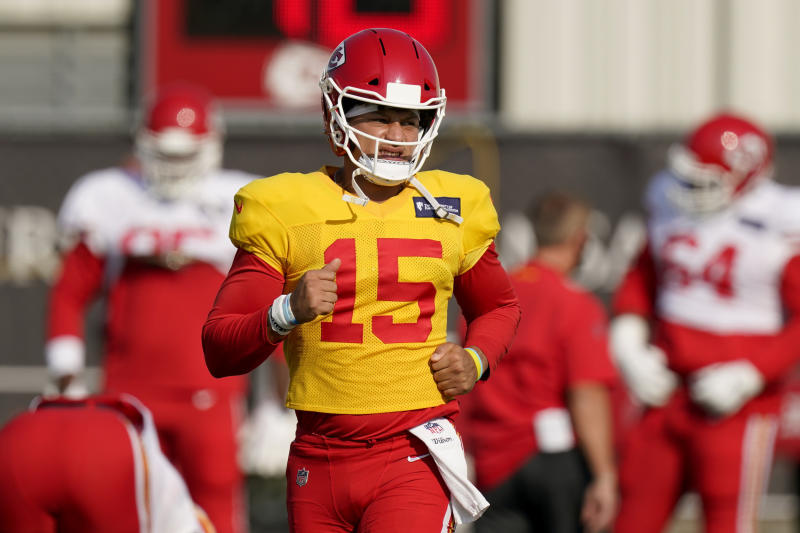 Kansas City Chiefs quarterback Patrick Mahomes runs during an NFL football training camp practice Monday, Aug. 24, 2020, in Kansas City, Mo. (AP Photo/Charlie Riedel)