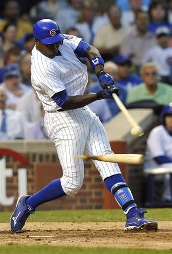 Chicago Cubs' Alfonso Soriano shatters his bat against the New York Mets during the third inning of a baseball game, Tuesday, June 26, 2012, in Chicago. (AP Photo/Jim Prisching)