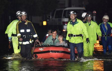 Firefighters rescue people with a boat in Asakura