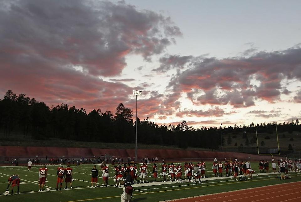 In terms of volume of fatalities, high school American football is the deadliest arena in US sport, with 11 deaths reported so far in 2015 (AFP Photo/Christian Petersen)