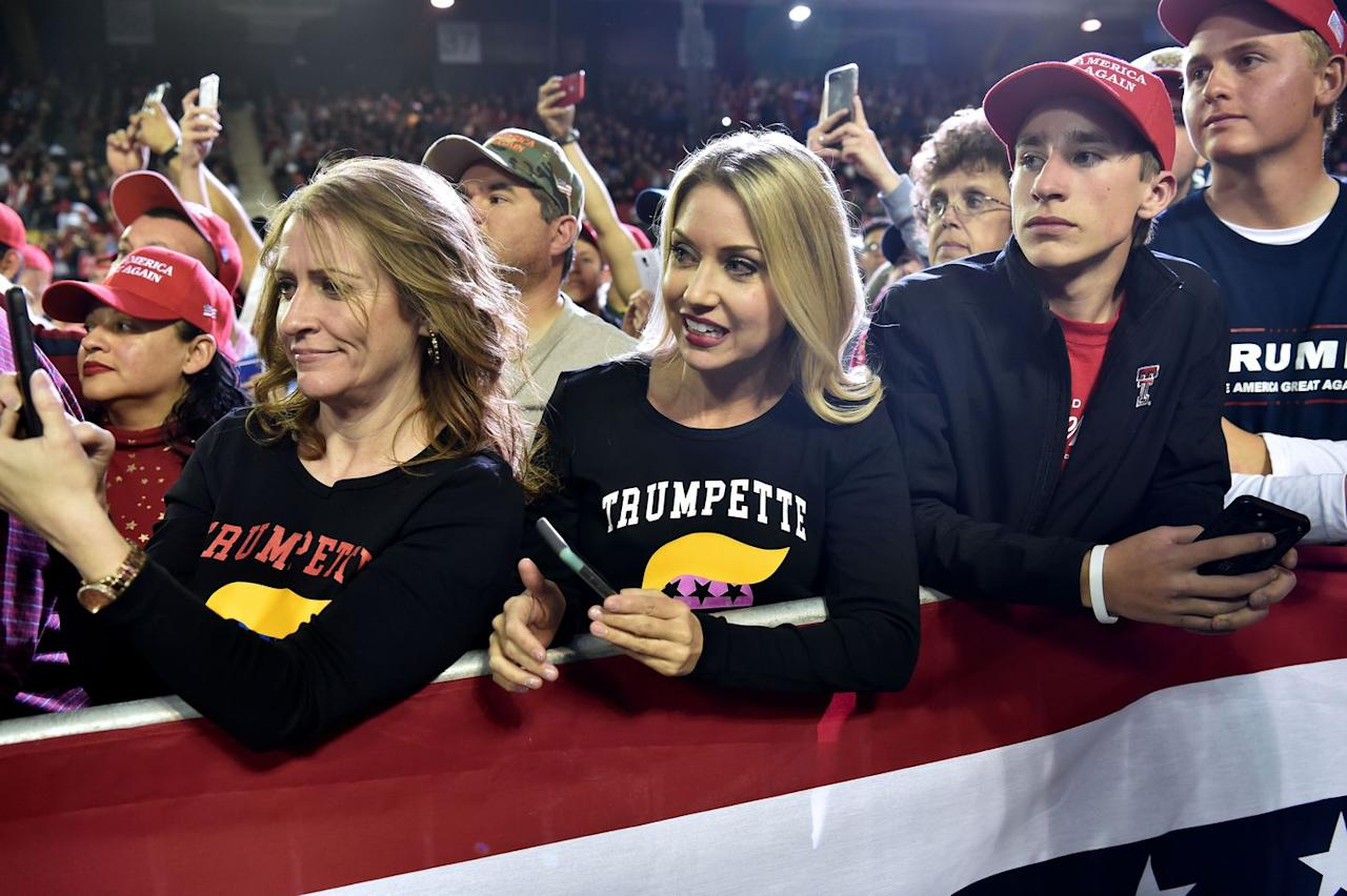 <p>Trump supporters look on as the president speaks in El Paso on Monday night. </p>