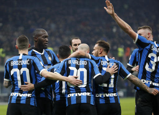 Inter Milan's Borja Valero, center, celebrates with teammates after scoring his side's second goal during an Italian Cup soccer match between Inter Milan and Cagliari at the San Siro stadium, in Milan, Italy, Tuesday, Jan. 14, 2020. (AP Photo/Antonio Calanni)