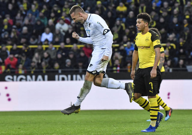 Hoffenheim's scorer Pavel Kaderabek, left, celebrates his goal beside Dortmund's Jadon Sancho, right, during the German Bundesliga soccer match between Borussia Dortmund and TSG 1899 Hoffenheim in Dortmund, Germany, Saturday, Feb. 9, 2019. The match ended 3-3. (AP Photo/Martin Meissner)