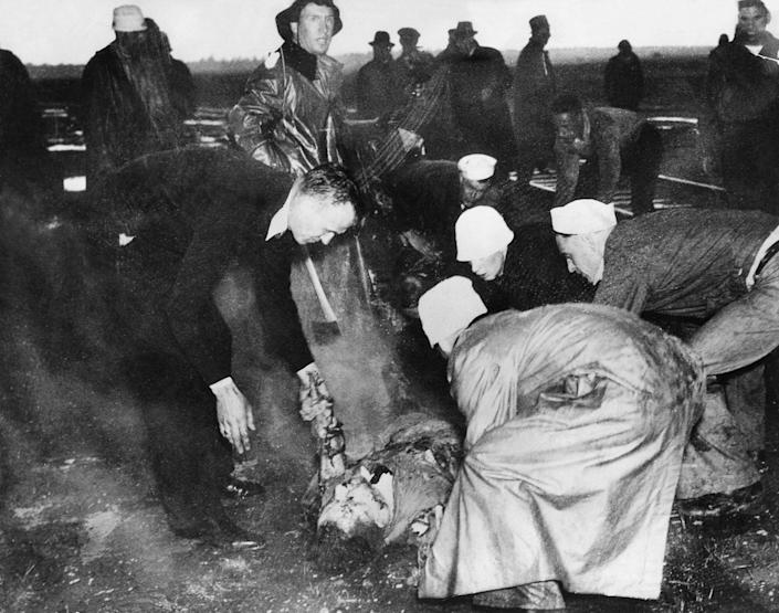 <p>Rescuers on the scene of the Hindenberg explosion in Lakehurst, New Jersey on May 6, 1937. (Heinrich Hoffmann/ullstein bild via Getty Images) </p>